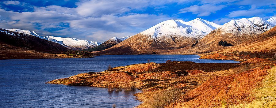 Snow capped mountains beside Loch Cluanie