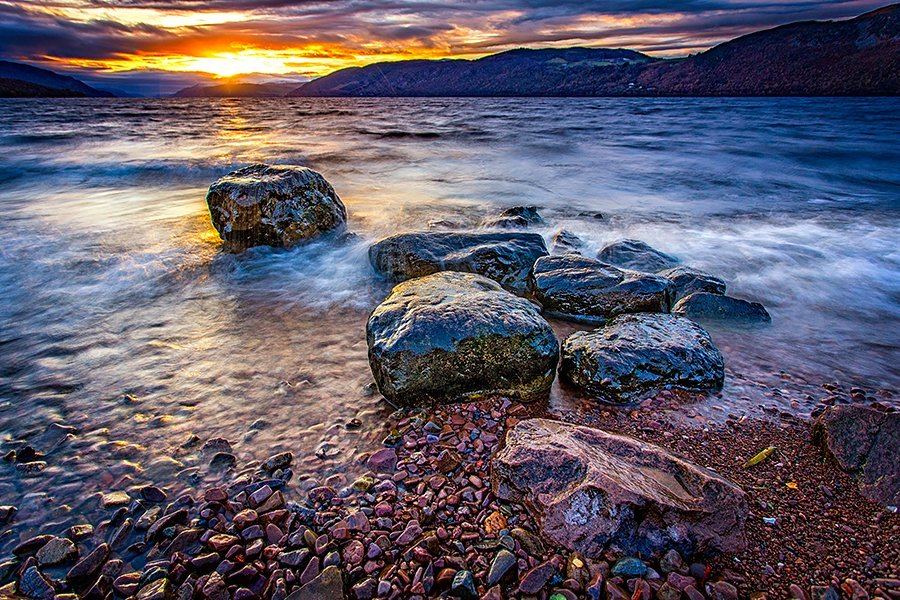 The sun is setting over Loch Ness