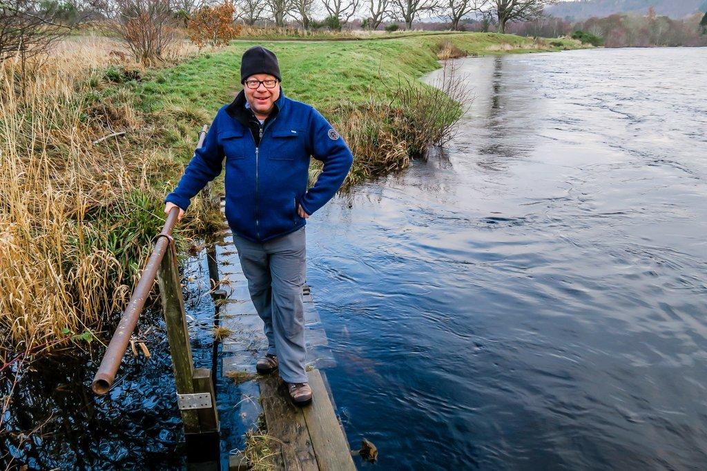 John braves the flooded bridge