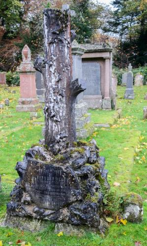 Unusual memorial shaped like a tree trunk, erected by Earl Cawdor to his forrester Alexander Black in 1883